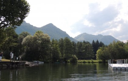 Walking in the forest or along the lake of Lourdes